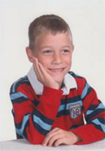 School picture of boy in striped shirt